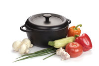 black cast-iron cauldron with vegetables