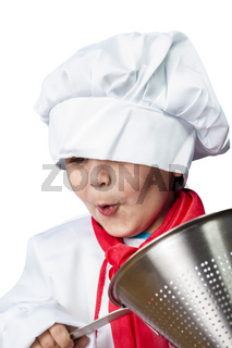 Isolated funny boy dressed in chef with pasta drainer