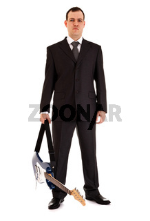 man in black suit stand with electric guitar