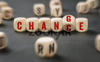 Letter dice with the words Change and Chance