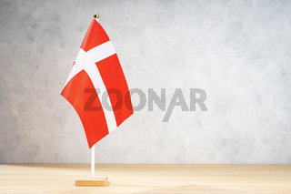 Denmark table flag on white textured wall. Copy space for text, designs or drawings