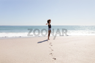 Mixed race woman standing on the beach
