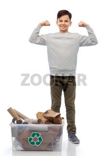 smiling boy sorting paper waste