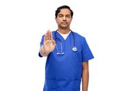 indian doctor or male nurse showing stop gesture