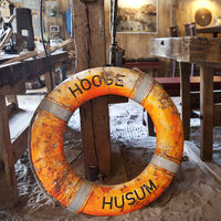 Old lifebuoy in the old shipyard, today a cafe at the historic harbor, Toenning, Germany, Europe