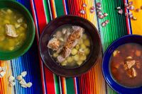 White, green and red pozole. Mexican pork and hominy corn stew