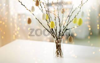 pussy willow branches decorated by easter eggs