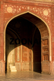 Portal and the interior of the mosque located in the Taj Mahal complex