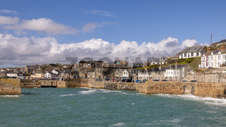 PORTHLEVEN, CORNWALL, UK - MAY 11 : View of the town and harbour in Porthleven, Cornwall on May 11, 2021. Unidentified people