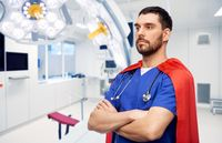 doctor or male nurse in superhero cape at hospital