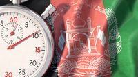 Symbolic image on the topic of Afghanistan and time. Stopwatch lies on Afghanistan flag.