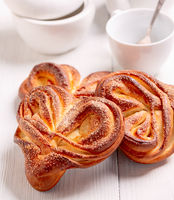 Sweet swirling buns sprinkled with sugar.