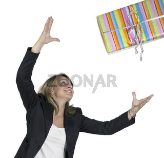 blond girl is throwing a present