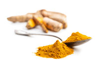 Indian turmeric powder. Turmeric spice. Ground turmeric on white background.