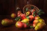 pears in bulk on a dark wooden background in a rustic style