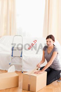 Woman preparing cardboards for transport