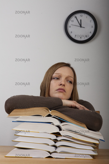 Student with books and watch