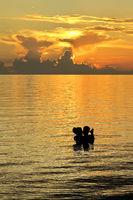 Orange Sunset  and Couple at the Beach, Isla de la Juventud, Cuba