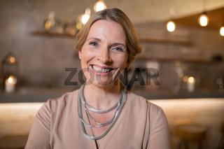 Portrait of beautiful woman standing in restaurant