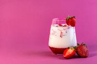 Strawberry milk in a glass.