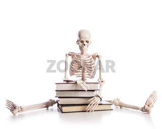 Skeleton with books isolated on white