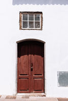 Traditional painted door in canarian colonial style house in the old town of Santa Cruz de La Palma