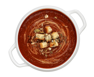 Bowl of tomato soup isolated on white background, top view