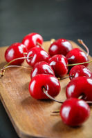 Fresh cherries on a wooden cutting board