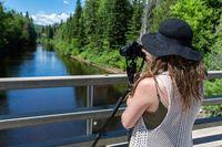 A woman capturing a beautiful landscape