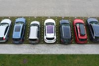 Parking lot with cars in front of a hotel in the city of Kolobrzeg in Poland from bird's eye view