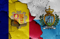 flags of Andorra and San Marino painted on cracked wall