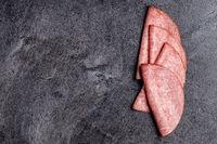 Sliced smoked salami.