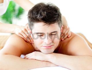 Handsome caucasian man having a back massage