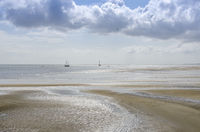 Wadden Sea with dry parts of the mudflats seen from the island of Terschelling