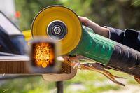 A welding machine running on a metal surface