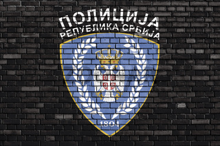 flag of Serbian Police painted on brick wall