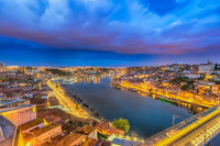 Porto Portugal night city skyline at Porto Ribeira and Douro River and Dom Luis I Bridge