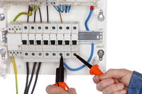 electrician is testing an electrical circuit
