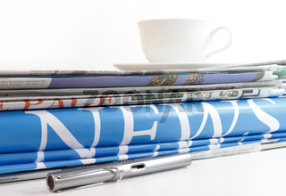 a coffee cup and newspaper background