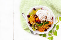 Salad fruit with cranberries in bowl on board top