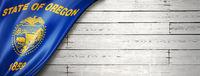 Oregon flag on white wood wall banner, USA