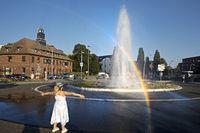 Monheim Geyser in the roundabout with rainbow, Monheim am Rhein, Germany, Europe