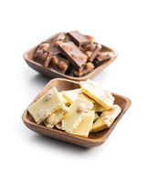 White and dark nutty chocolate with hazelnuts in bowl