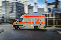 Ambulance transport with blurred motion.