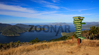 Sign post on top of a hill, Marlborough Sounds, New Zealand.
