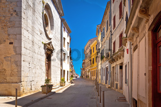 Town of Vodnjan colorful street and stone church view