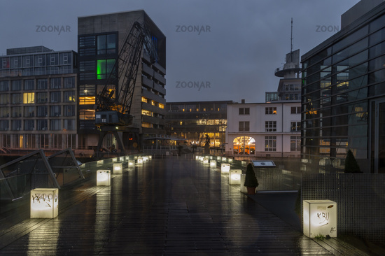 Pedestrian bridge in the media harbor at dusk