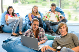 Students sitting on beanbags in study room in study room