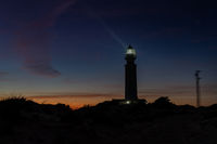 the Cape Trafalgar lighthouse signal light after sunset with colorful evening sky