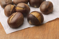 Organic roasted chestnuts on baking paper
